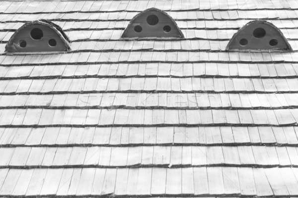 Fragment of old wooden roof of the house Stock photo © alekleks