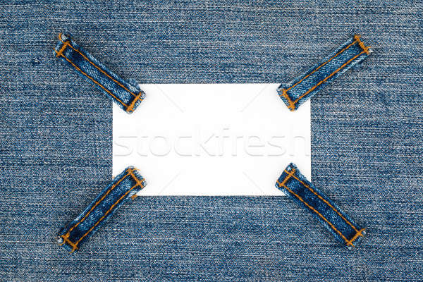 Business card with four straps jeans, lies on the light denim Stock photo © alekleks