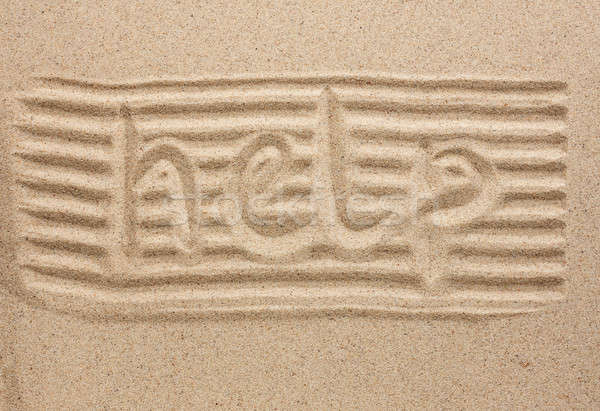 Word help written in the sand Stock photo © alekleks