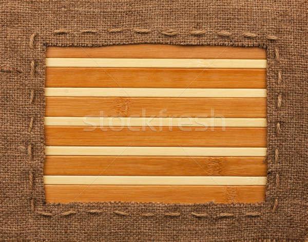 Frame of burlap, lies on a bamboo mat Stock photo © alekleks