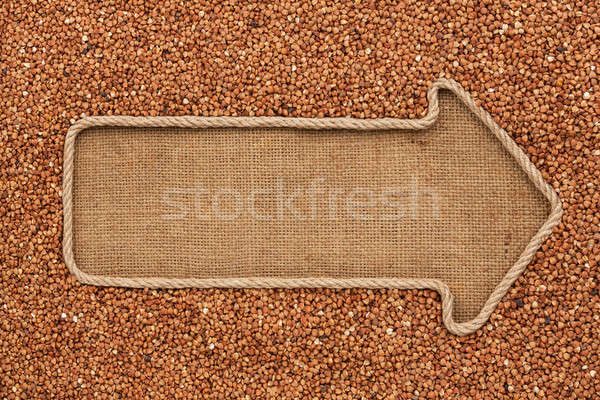 Pointer made from rope with grain buckwheat  lying on sackcloth Stock photo © alekleks