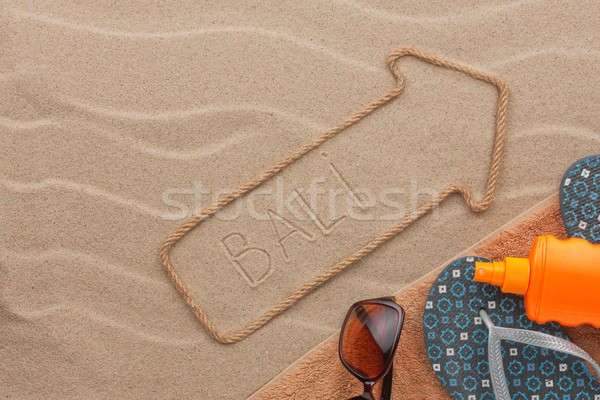 Bali pointer and beach accessories lying on the sand Stock photo © alekleks