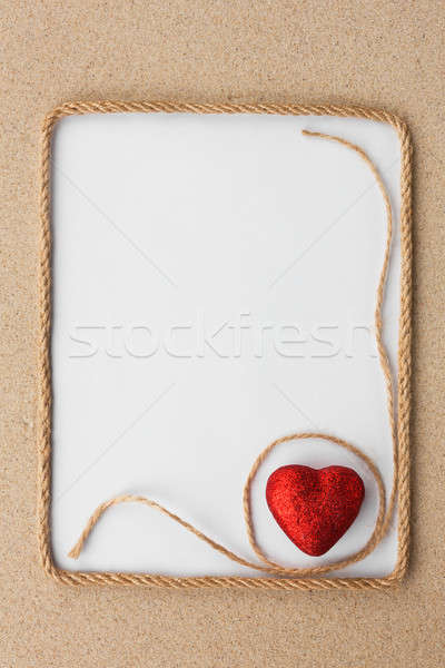 Beautiful frame of rope and red heart with a white background on Stock photo © alekleks