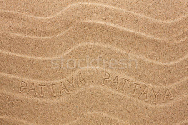 Pattaya  inscription on the wavy sand Stock photo © alekleks