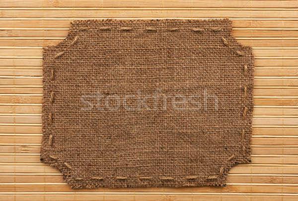 Keret zsákvászon hazugságok bambusz hely absztrakt Stock fotó © alekleks