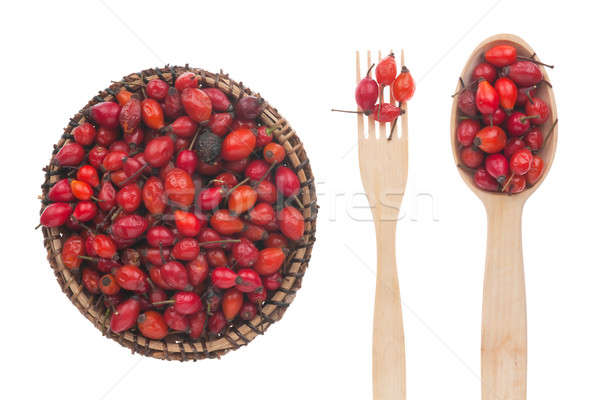 Rosehip in a plate, fork and spoon Stock photo © alekleks
