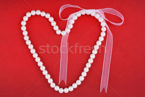 Symbolic heart of beads  with bow Stock photo © alekleks