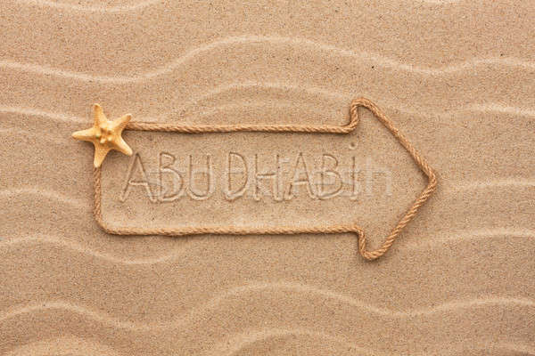 Arrow made of rope and sea shells with the word Abu dhabi on the Stock photo © alekleks