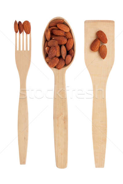 Wooden spoon,fork, shovel with almonds Stock photo © alekleks