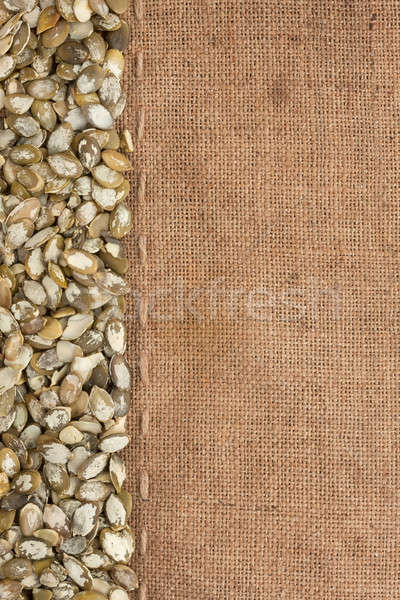 Pumpkin seeds were lying on sackcloth Stock photo © alekleks