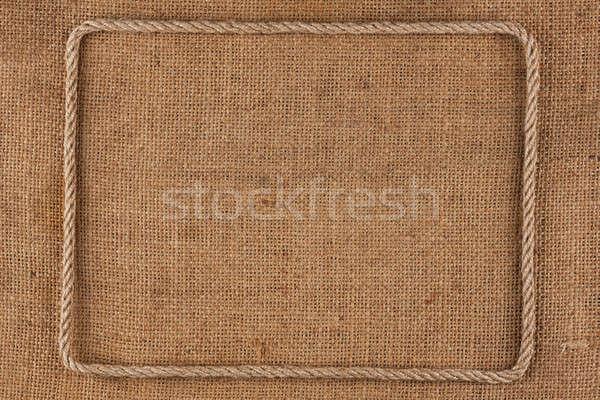 Frame of rope, lies on a background of burlap Stock photo © alekleks
