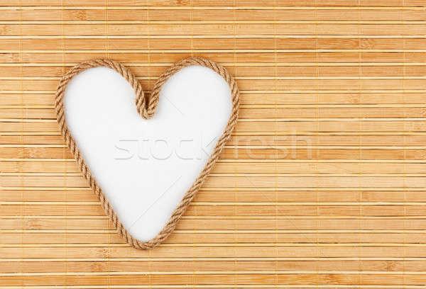 Symbolic heart made of rope lying on a bamboo mat Stock photo © alekleks