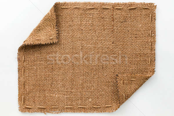 Frame of burlap with curled edges, lies on a white background Stock photo © alekleks
