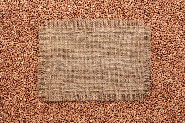 Frame made of burlap with the line lies on  buckwheat  grains Stock photo © alekleks