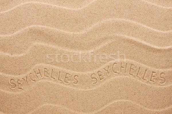 Seychelle-szigetek felirat hullámos homok tengerpart textúra Stock fotó © alekleks