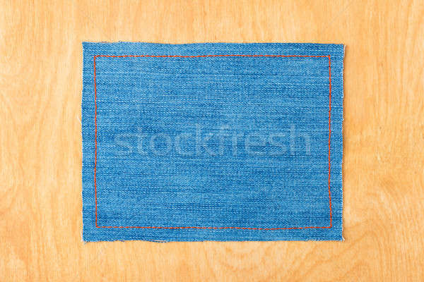 Frame for the text from a blue jeans fabric with the stitched lines of an orange thread Stock photo © alekleks