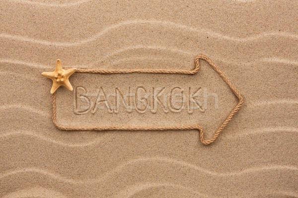 Arrow made of rope and starfish with the word Bangkok on the san Stock photo © alekleks