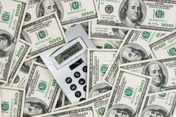 Background of $ 100 bills and a calculator Stock photo © alekleks