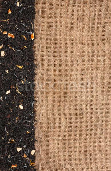 Black tea with additives lies on sackcloth Stock photo © alekleks
