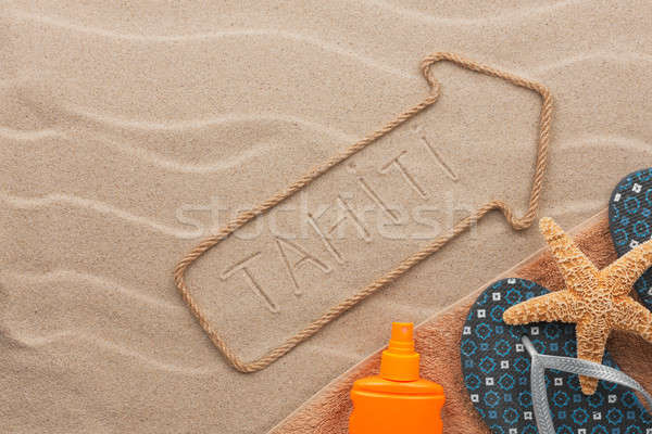 Tahiti pointer and beach accessories lying on the sand Stock photo © alekleks