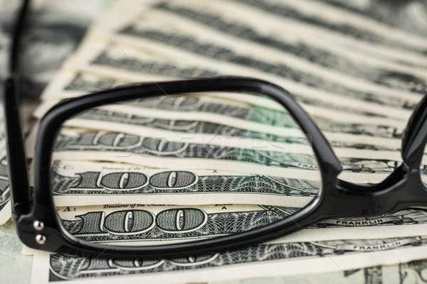 Közelkép szemüveg dollár szem divat pénzügy Stock fotó © alekleks