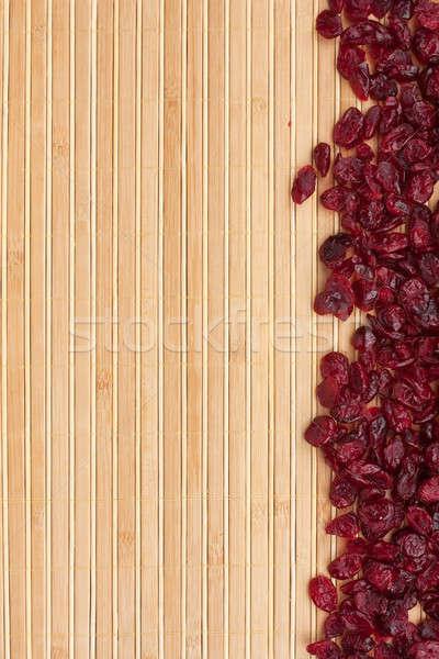Dried cranberry  lying on a bamboo mat Stock photo © alekleks