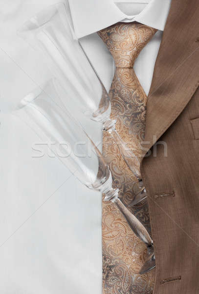 Two glasses lie on the jacket and shirt Stock photo © alekleks