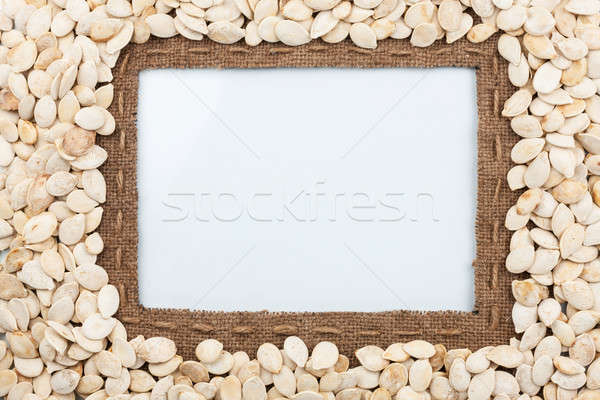 Frame made of burlap with the line and pumpkin seeds lies white  Stock photo © alekleks