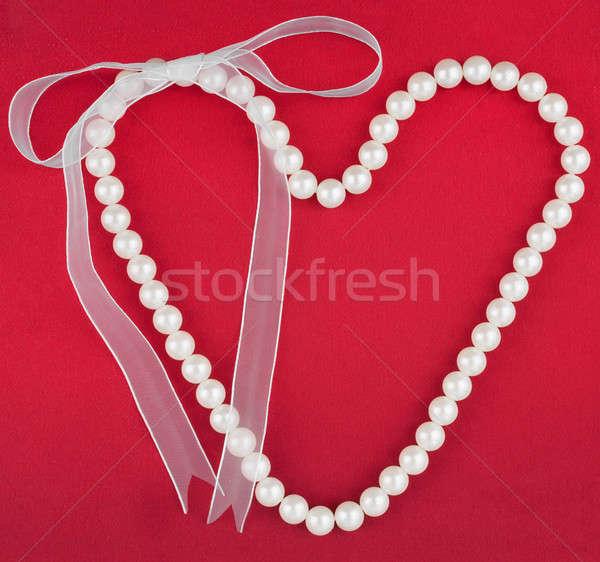 Sembolik kalp boncuk kırmızı kumaş dizayn Stok fotoğraf © alekleks