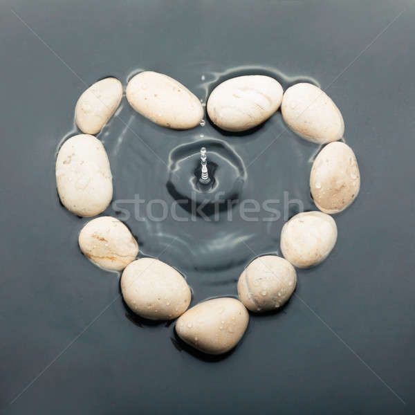 Conceptual heart of the stones in the water Stock photo © alekleks