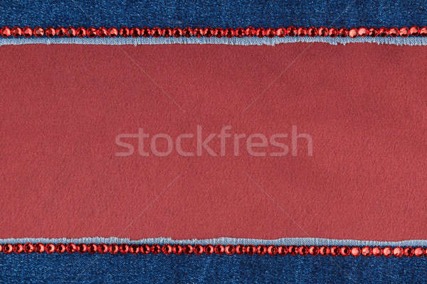 Fashionable background,  jeans and red  rhinestones  Stock photo © alekleks