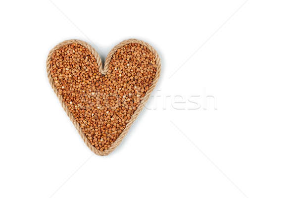 Symbolic heart made from rope with buckwheat grains  Stock photo © alekleks