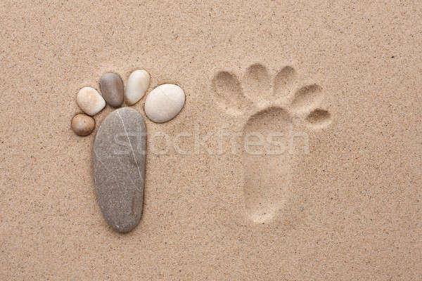 The footprint made up of stones  Stock photo © alekleks