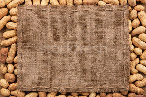 Frame made of burlap with the line lies on peanut Stock photo © alekleks