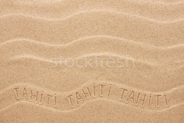 Tahiti  inscription on the wavy sand Stock photo © alekleks