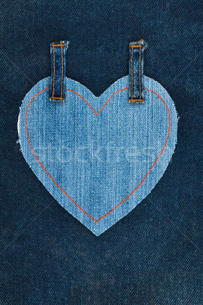 Heart made of denim fabric with yellow stitching on dark denim Stock photo © alekleks