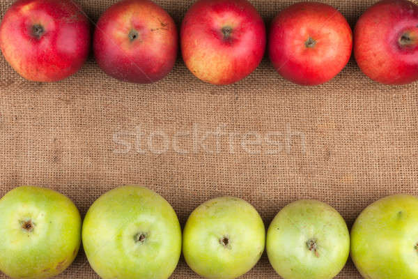 Green and red apples lie on sackcloth Stock photo © alekleks
