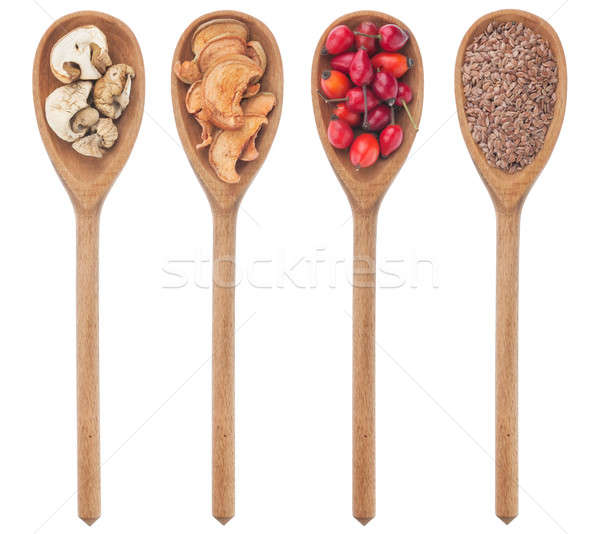 Spoons with flax, mushrooms, wild rose, apple Stock photo © alekleks