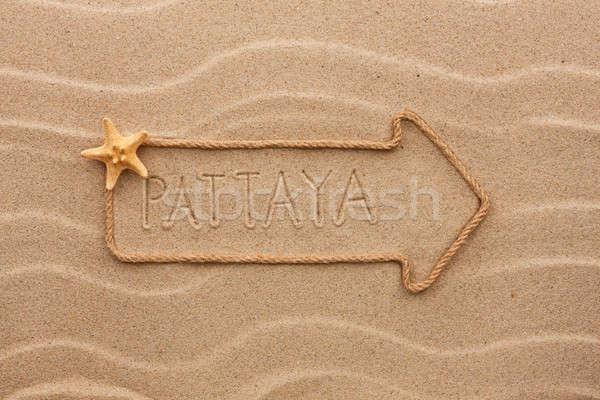 Foto d'archivio: Arrow · corda · mare · conchiglie · parola · sabbia