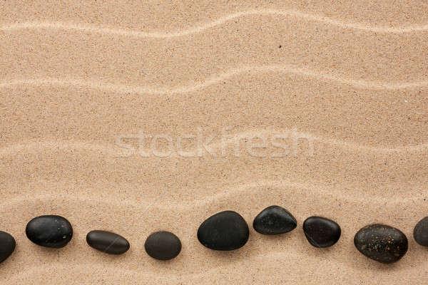 Сток-фото: черный · камней · лежать · песок · можете · используемый