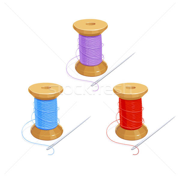 Colored thread reel with needle. Stock photo © Aleksangel