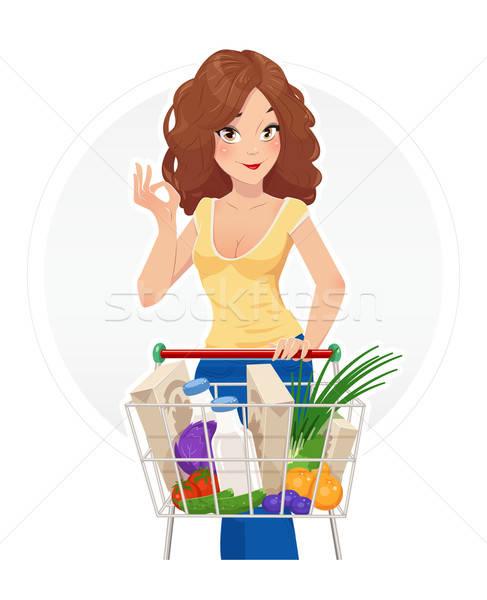 Shopping. Beautiful girl with shopping cart. Stock photo © Aleksangel