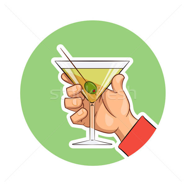 Glass of martini with olive in hand Stock photo © Aleksangel