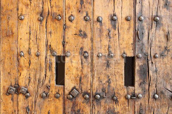Starożytnych drewna przednie drzwi zamek domu Zdjęcia stock © alessandro0770