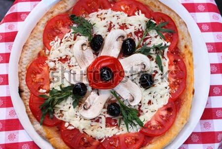 Pizza with mozzarella and mushrooms Stock photo © alessandro0770
