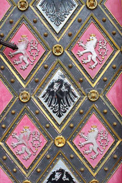 Wooden door with emblems Stock photo © alessandro0770