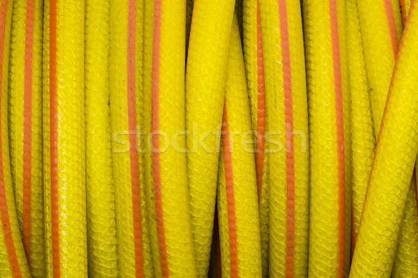 Yellow and orange water hose Stock photo © AlessandroZocc