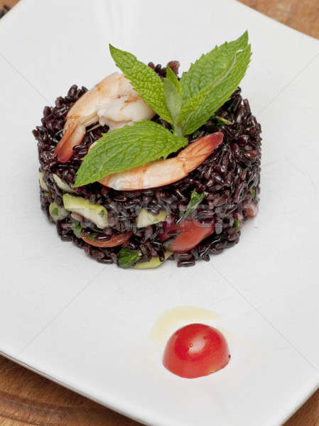 A dish of black rice, shirmps and vegetables Stock photo © AlessandroZocc