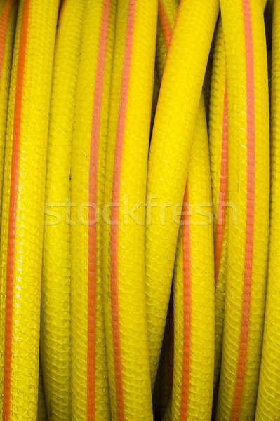 Yellow and orange water hose Stock photo © AlessandroZocc