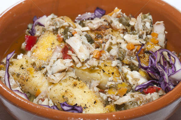 A earthenware dish with gratinated pike fish and vegetables Stock photo © AlessandroZocc